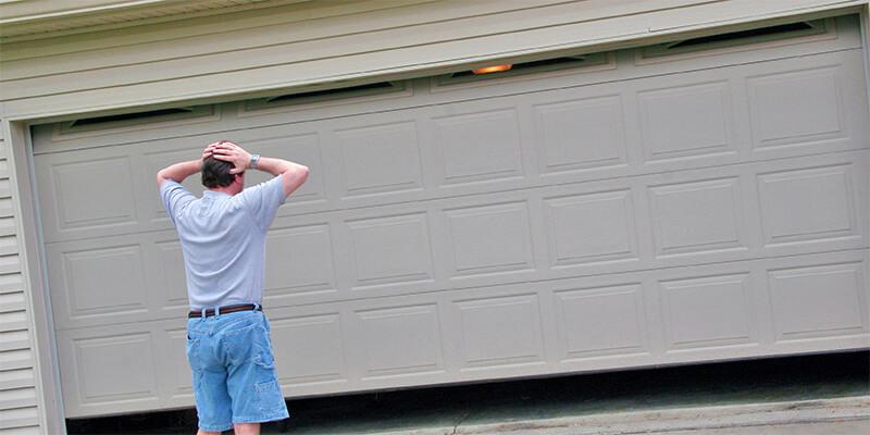 garage door repair person - Johnsons Mobile Garage Door Repair